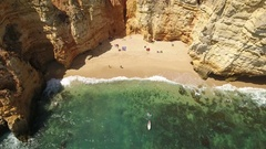 Aerial. Small beach with tourists, in the bay Ponta de Piedade. Algarve Lagos. Stock Footage