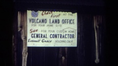 1969: sign: volcano land office for your home site; see general contractor Stock Footage