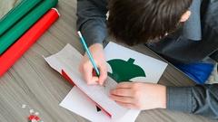 Teen Boy making Christmas card Stock Footage