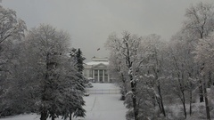 President palace in winter with flag Stock Footage