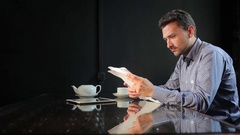 The man looking at the documents in the restaurant Stock Footage