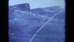 1971: steam billows up from freshly cut logs. MAINE Stock Footage