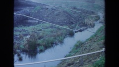 1971: a large area full of water covered with many trees on its sides MAINE Stock Footage