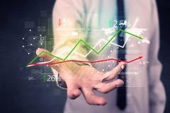 Businessman holding stock data Stock Photos