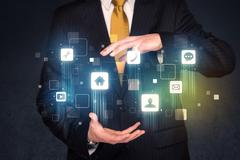 Businessman holding blue applications Stock Photos