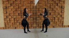 Beautiful brunette acts oriental dance in front of mirror Stock Footage