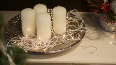 Decorated Christmas tree in the foreground with the movement on the candles on a Stock Footage