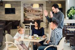 Family, parenthood, technology, people concept - happy mother, father and little Stock Photos