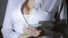 Beautiful young slim girl considers money Stock Footage