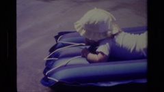 1978: a baby on a floatation device CANYON LAKE CALIFORNIA Stock Footage