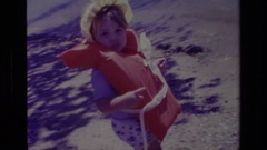 1978: little girl approaching beach in a life vest CANYON LAKE CALIFORNIA Stock Footage