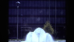 1969: dandelion sprinklers outside of glass building CALIFORNIA Stock Footage