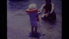 1978: child learning the art of water CANYON LAKE CALIFORNIA Stock Footage