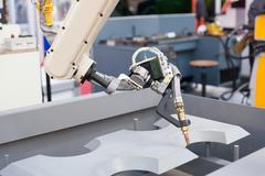 Industrial welding robotic arm Stock Photos