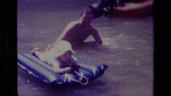 1978: people playing in a body of water and having a great time CANYON LAKE Stock Footage