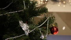 Christmas tree from top to bottom with a rear background flickering with candles Stock Footage
