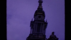 1969: a very old cathedral with a cross at the pinnacle and an old clock LONDON Stock Footage