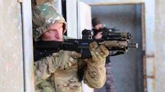 Armed SWAT Trainee Guards Open Doorway Stock Footage