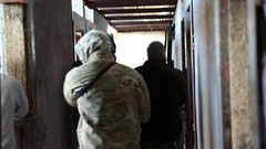SWAT Trainees Line Up in Hallway in Training Exercise Stock Footage
