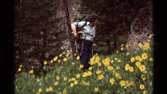 1975: a smiling lady adjusts her backpack while hiking AGATE SPRINGS MONTANA Stock Footage