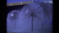 1969: large, multi-head sprinkler-like displays in a courtyard or square Stock Footage