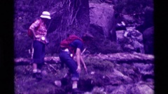 1975: family and friends venture through the woods  Stock Footage