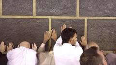 Muslim pilgrims touching the wall of Kaaba in Mecca in Saudi Arabia (Editorial) Stock Footage