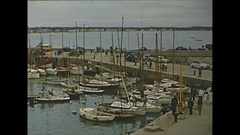 Vintage 16mm film, 1955 France, people pier and boats Stock Footage