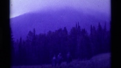 1975: a small group of men walk through the forest at dusk AGATE SPRINGS MONTANA Stock Footage