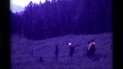 1975: group of people hiking in the wilderness AGATE SPRINGS MONTANA Stock Footage