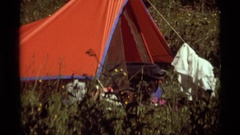 1975: getting dressed in a tent AGATE SPRINGS MONTANA Stock Footage