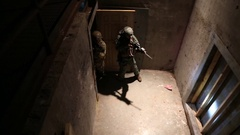 High Angle View of SWAT Trainees Entering Doorway Stock Footage