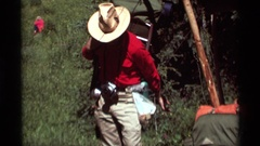 1975: number of tourist people walking in a forest area AGATE SPRINGS MONTANA Stock Footage