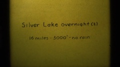1975: sign: silver lake overnight (2), 16 miles, 3,000, no rain AGATE SPRINGS Stock Footage