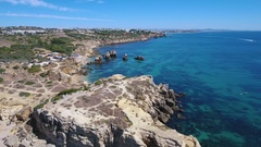 View the beach Arrifes with leisure travelers, filmed from the sky. Albufeira. Stock Footage