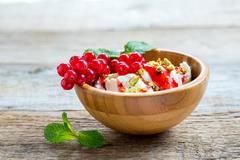 Ice cream with red currant sauce and pistachios. Stock Photos