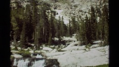1975: water flowing in full force in between huge rocks and trees AGATE SPRINGS Stock Footage
