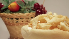 Bread plate and savory donuts. Stock Footage