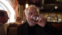 Middle-aged Man with a Beard drink tastes the Wine at Restaurant cozy Stock Footage
