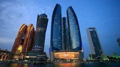 Etihad Towers in Abu Dhabi at night Stock Footage