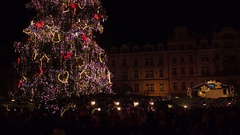 PRAGUE, CZECH REPUBLIC - DECEMBER 3, 2016. Tilt shot of crowded city square and Stock Footage