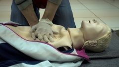 Rates of first aid from the Red Cross - chest compressions On A Mannequin Stock Footage