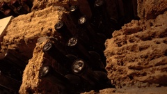 Bottles of wine stored in the basement in stone niches Stock Footage