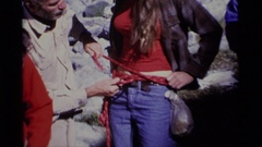 1975: a rope being tied around a woman in preparation for bungee jumping MINARET Stock Footage