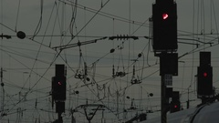 Railway signals and high voltage wires Stock Footage