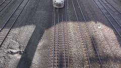 Amtrak train passes under overpass Stock Footage