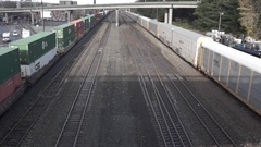 Freight rail cars run on a parallel track Stock Footage