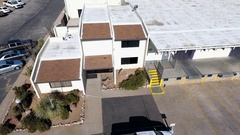 Aerial of loading docks at a distribution warehouse Stock Footage