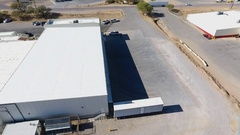 Orbiting aerial shot of warehouse loading docks Stock Footage