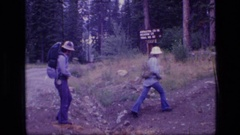 1973: a group of people begin their trek through the woods SCAPEGOAT WILDERNESS Stock Footage
